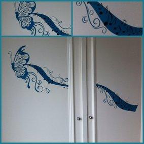 Vlinder op kastdeuren